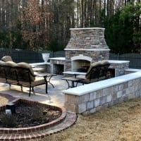 Fireplace with paver patio and sitting wall